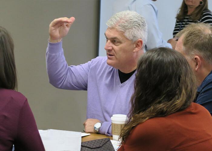 Phil Warrick helping attendees